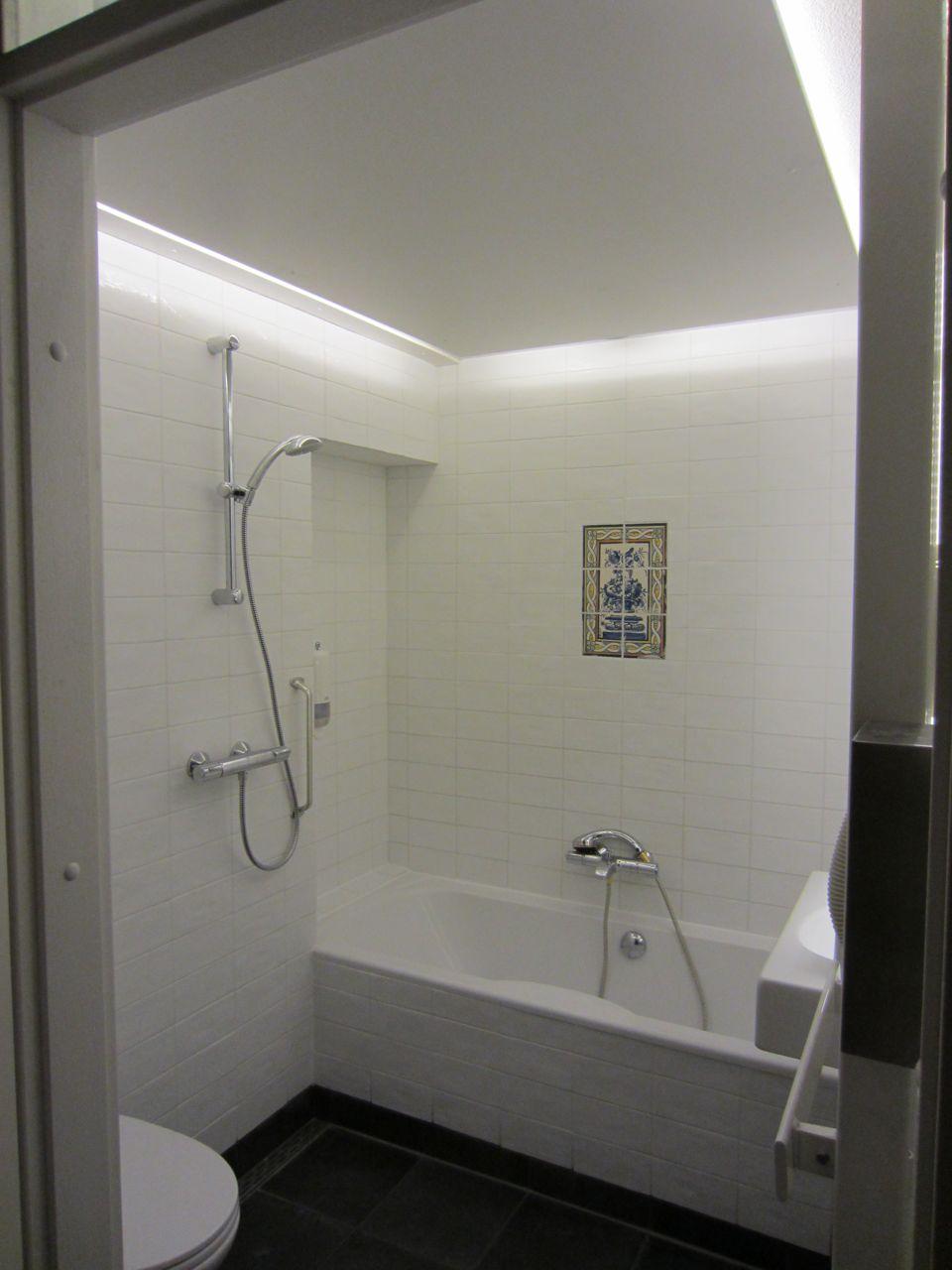 Badkamer verlichting: afstand verlichting badkamer volgens het arei.